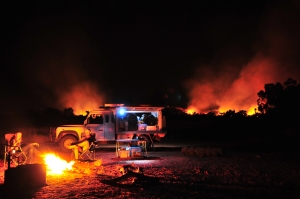 A bushfire burns behind Well 23 on the Canning Stock Route ©Summer Wilms 2012