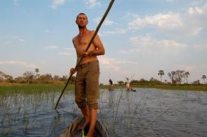 Poling a mokoro (traditional canoe) in Botswana's Okavango Delta